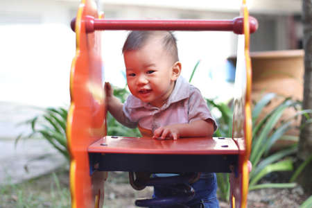 Asian baby at playground photo
