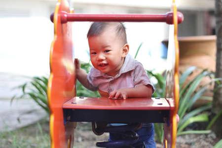 Asian baby at playground Stock Photo