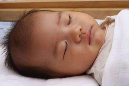 Asian baby asleep photo
