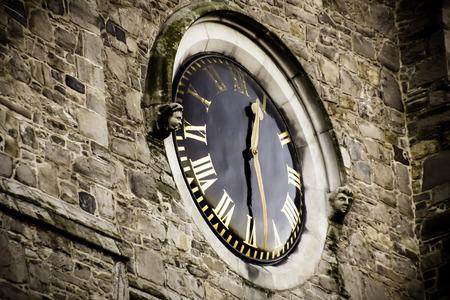 Saint Patrick Cathedral Clock closeup, Dublin Ireland photo