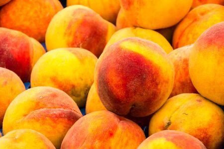 Colourful fresh, ripe peach background