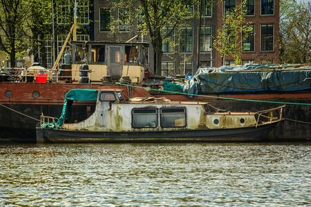 Houses and Boats on Amsterdam Canal