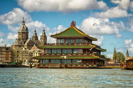 Historical church and famous floating Chinese restaurant in Amsterdam