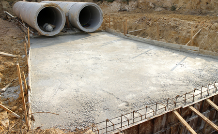 concrete construction: Concrete drainage tank on construction site Stock Photo