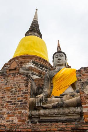 chaimongkol: Buddha Statue at Wat Yai Chaimongkol - Ayutthaya.In front of the pagoda Stock Photo