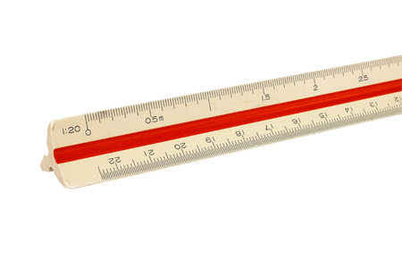 millimetre: A ruler placed on the desk. Focus in the front. Stock Photo