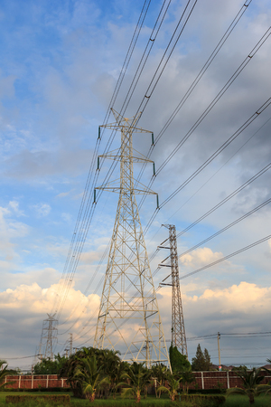 Electricity post in the evening with blue sky and the land.