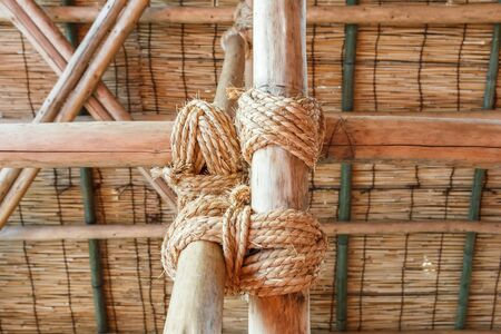 tied: Rope tied wood pole together. Stock Photo