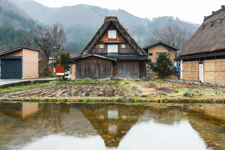 reflect: Reflect of house at Shirakawago in water.