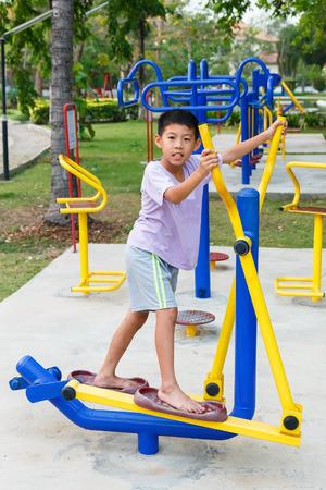 elliptical: Thai boy working out with Elliptical.