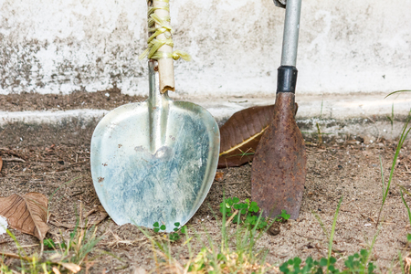 spade: Spade and showel on the ground.