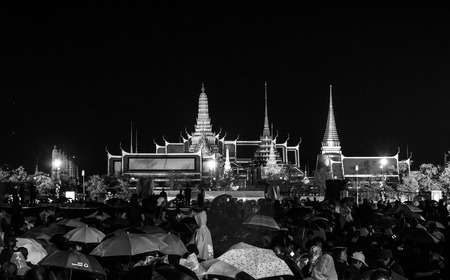 Bangok, Thailand - October 22,2016 :Thai people come for singing the song of His Majesty King Bhumibol Adulyadej at Sanam Luang in front of the Royal Palace to pay respect in Bangkok,Thailand.