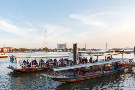 chao praya: Bangkok, Thailand - November 29: People on ferry boat across Chao Praya river on November 29, 2016 in Bangkok, Thailand. Editorial