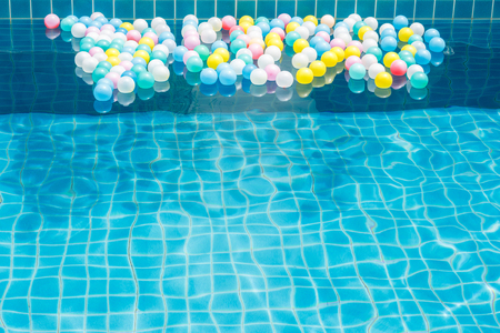 circular blue water ripple: Colorful plastic balls in swimming pool. Stock Photo