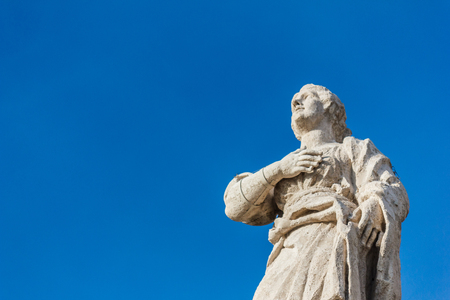 Sclupture at Vatican with blue sky.