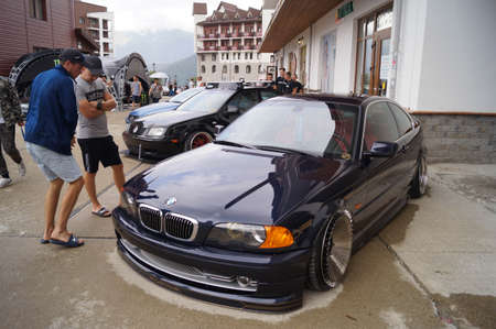 Sochi, Russian Federation, August 2018: Open automobile festival Grounded event. Unusual BMW car tuning, air suspension, sports parts and polished wheels. Stance. In the hotel parking lot.