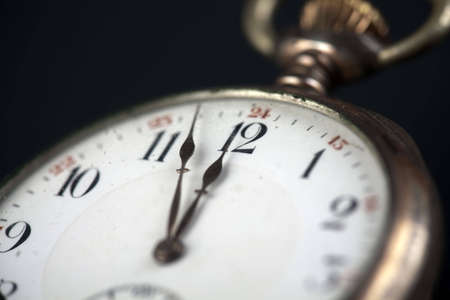past midnight: Old pocketwatch showing three minutes to twelve Stock Photo