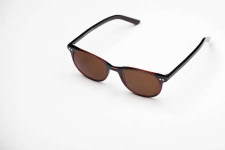 Brown sunglasses on white background photo