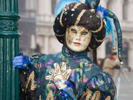 Person in jester costume at the Venice Carnival photo