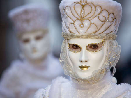 A couple in costumes at the Venice Carnival photo