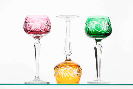 Red, green and yellow crystal wineglasses photo