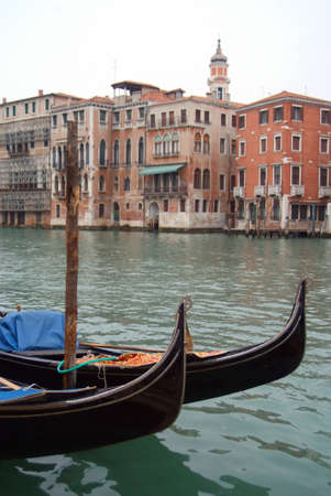 Gondolas in foreground with classical venetian architecture in background, Venice Italy Stock Photo - 4050735