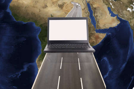 super highway: Technology concept with laptop world map and road