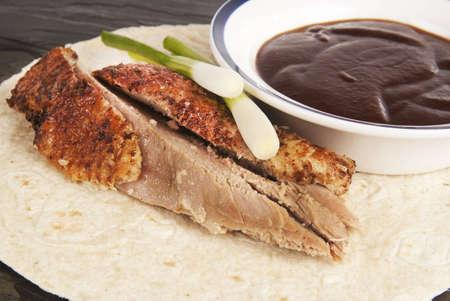 hoisin: Hoisin duck with rice wrap rice and spring onions against grey