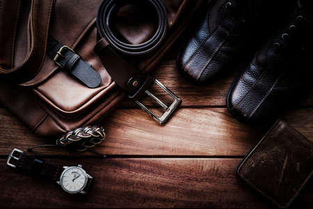 Men's leather accessories on rustic wooden background, fashion and beauty, travel concept