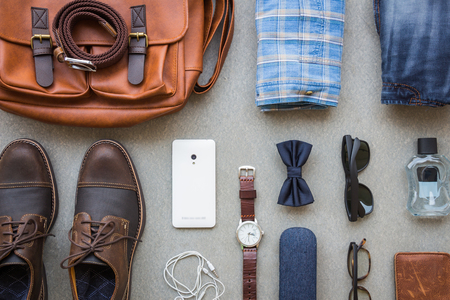 Men's casual outfits with accessories on gray background