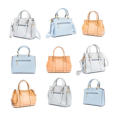 Collection of women's accessories with handbags isolated on white background