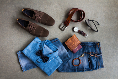 Men's casual clothes outfits with jeans, leather shoes and accessories on gray background Standard-Bild