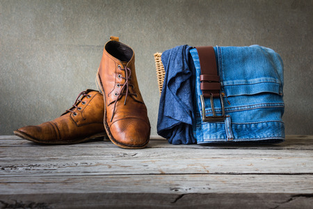Men's casual outfits on wooden table over grunge background