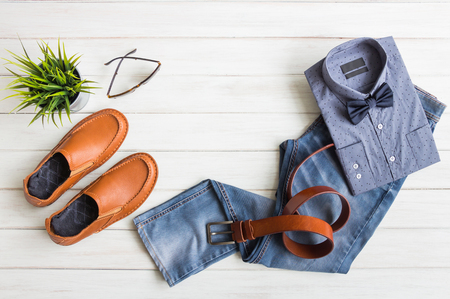 Fashionable concept, men's clothes with accessories items on white wooden board background with copy space Standard-Bild