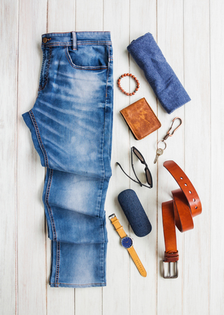 Men's casual outfits with jeans clothing and accessories on white wooden board background, fashion and beauty concept, flat lay