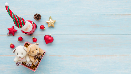Christmas and Happy New Year holidays with decoration items on blue rustic wooden background Standard-Bild