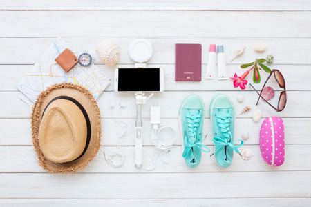 Overhead top view, flat lay, Women's accessories and essential travel items on white wooden board background Standard-Bild