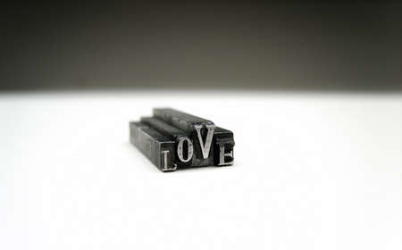 Love- printers metal symbols. Stock Photo - 11687907