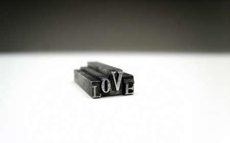Love- printers metal symbols. Stock Photo - 11687907