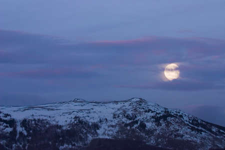 Moon over Vitosha mountain, covered with snow