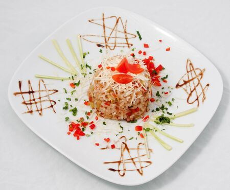 Rice with tomato and pepper covered with cheese Stock Photo