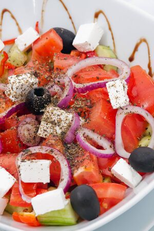 Tomato salad with cucumber, onion and cheese Stock Photo - 13556932