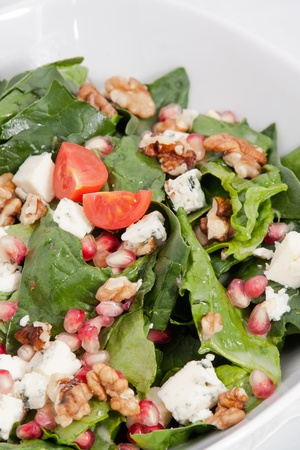Spinach salad with nuts and cheese Stock Photo