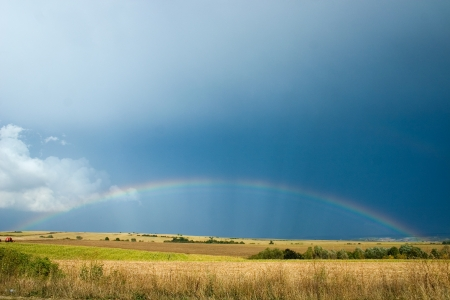Photograph of a rainbow over agriculture field Stock Photo - 13955670