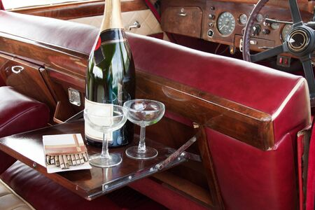 Champagne serving in english retro car Stock Photo