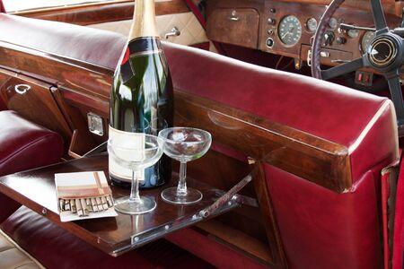 Champagne serving in english retro car Stock Photo