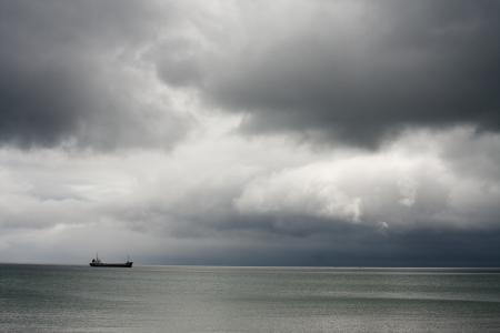 Merchant vessel on stormy background photo
