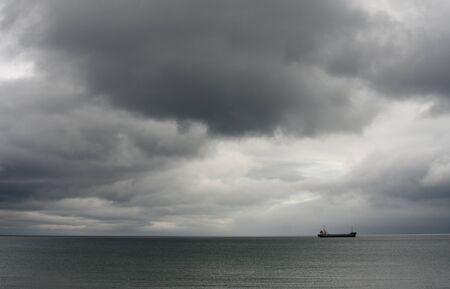 Merchant vessel on stormy background