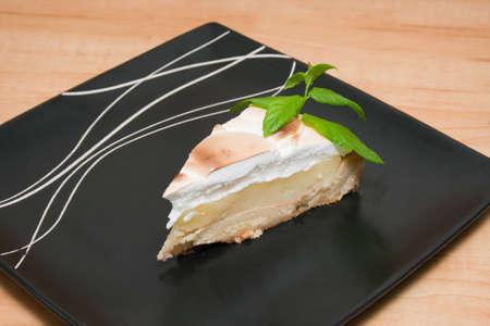 Homemade lemon meringue pie with mint Stock Photo