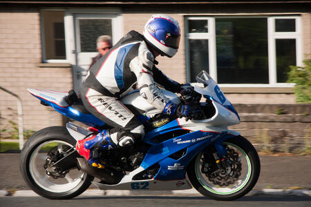 Wayne Kirwin  Eire  cycling  on TT Isle of Man.  Picture taken on 26 05 2014 at Ramsey, Isle of Man.  Tourist Trophy is yearly motorbike freestyle competition, with over 100 years history  Thousands of  people are coming on the Island to watch the show  Editorial